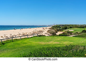 Resort luxury beaches, golf courses with palm trees, overlooking the sea for tourists to relax.
