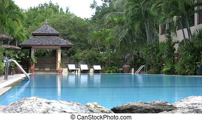 Resort Pool - A cool shot of a swimming pool at a luxurious...