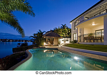 Resort style living - Luxurious mansion exterior at dusk ...
