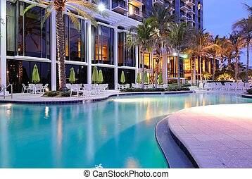 Resort Swimming Pool - A resort swimming pool at twilight