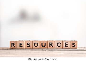 Resources sign on a wooden table