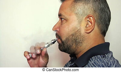 Respectable man smoking electronic cigarette
