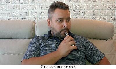 Respectable man smoking electronic cigarette - Respectable...