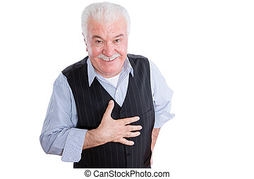 Isolated single mature man with smile and respectful expression gesturing as hand is on chest