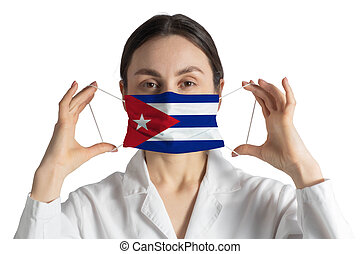 Respirator with flag of Cuba Doctor puts on medical face mask isolated on white background