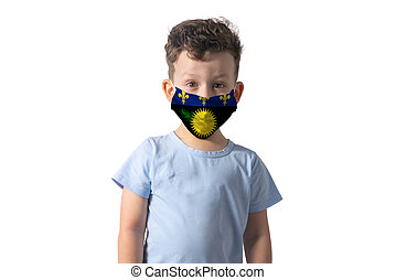 Respirator with flag of Guadeloupe. White boy puts on medical face mask isolated on white background