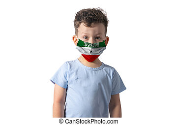 Respirator with flag of Guam. White boy puts on medical face mask isolated on white background