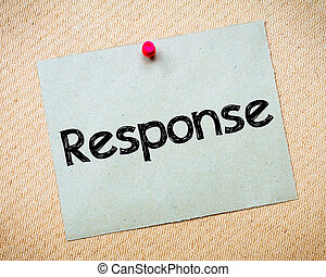 Response Message. Recycled paper note pinned on cork board. ...