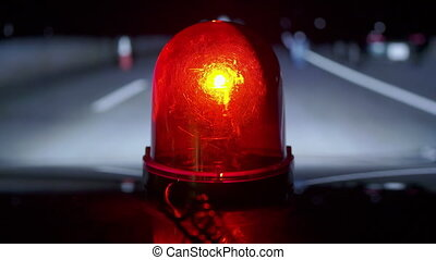 Response to road traffic accident at night. Vehicle with red...