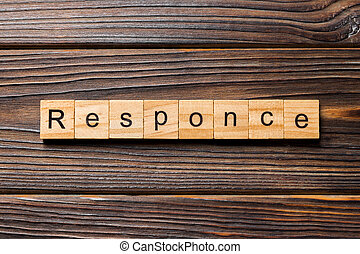 RESPONSE word written on wood block. RESPONSE text on wooden table for your desing, concept