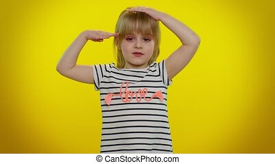 Yes sir. Subordinate, responsible serious little child kid girl giving salute listening to order as if soldier, following discipline, obeying, expressing confidence. Yellow background. Young children