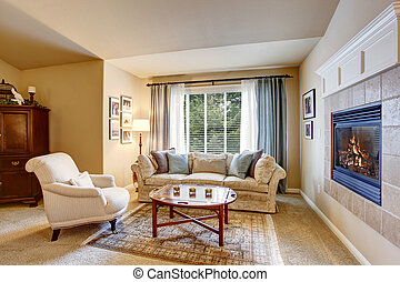 Rest area in the bedroom with sofa and armchair.