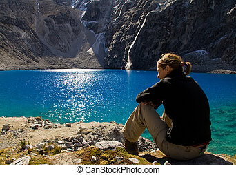 rest at the lake - young girl resting at an amazing blue...