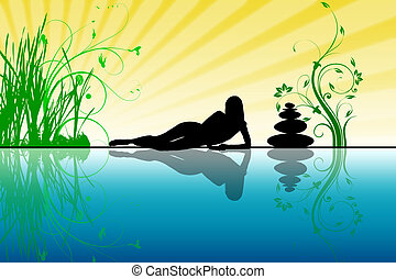 The woman lays ashore, near water and sunbathes