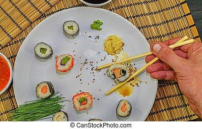 restaurang, äta, -up, sushi, japansk, hand, matpinnar, nära, rulle
