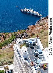Restaurant cafe and a moored ship at the caldera, Fira Santorin Greece