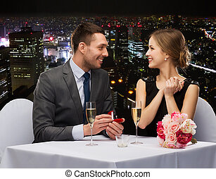 man proposing to his girlfriend at restaurant - restaurant, ...