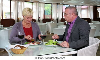 Restaurant date - Senior couple dating at restaurant having...