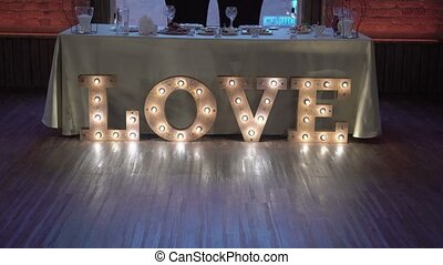 Restaurant decoration for wedding - love sign made with lamps