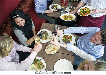 Restaurant dinner - A group of friends having dinner at a...