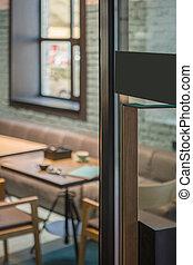 Restaurant door handle with pull sign on glass doors