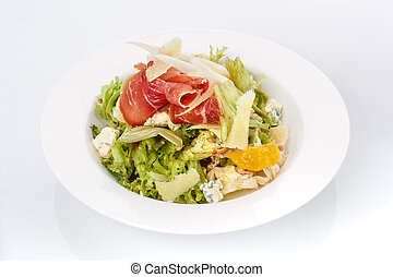 Restaurant food. Salad in a plate. Delicious food.