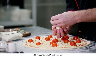 Restaurant kitchen. A chef putting special large pieces of...