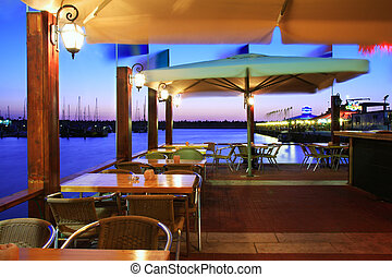 Outdoor restaurant at sunset on Marina in Ashqelon, Israel.