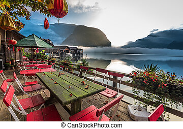 Restaurant on the lake at dawn in the Alps