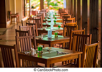 restaurant on the open veranda, tables are in a row