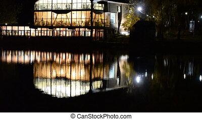 Restaurant on the water. Night refl