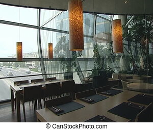 Restaurant over busy street. Romantic and modern interior view
