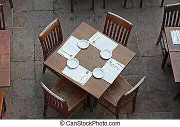 Overhead view of casual dining restaurant with wooden table and chairs