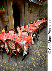 Restaurant patio - Outdoor restaurant patio on the street of...