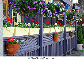 Restaurant patio - Colorful fence of a restaurant patio with...