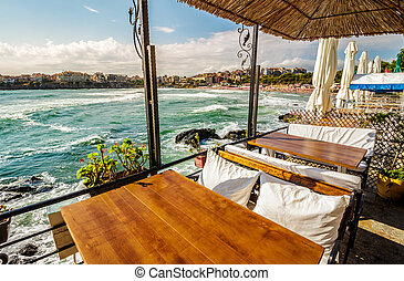 restaurant place at the seashore - restaurant table with...