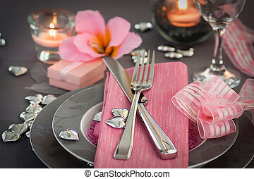 Restaurant series. Valentines day dinner with table setting in pink and gray and holiday elegant heart ornaments