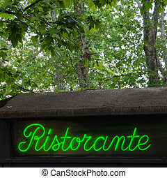 Restaurant sign, in Italy - Restaurant sign by an old roof...