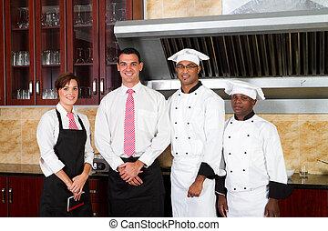 restaurant staff in kitchen - restaurant staff inside...