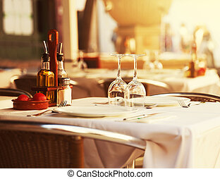 Restaurant table at sunset