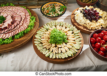 Restaurant table full of meat and vegetable appetizers