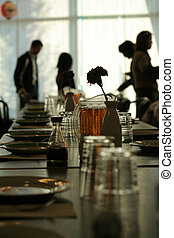 restaurant table setting and people profile