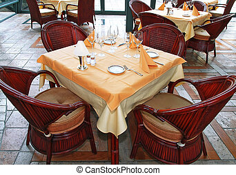 Restaurant table with complete tableware setup