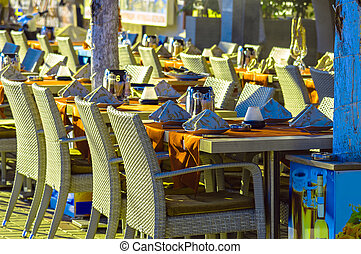 Restaurant tables and chairs on street