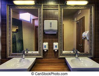 Restaurant toilet interior with modern contemporary...