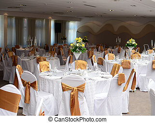 Restaurant with tables set for wedding dinner