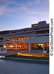 Restaurant's illumination of luxury hotel during sunset, Crete, Greece
