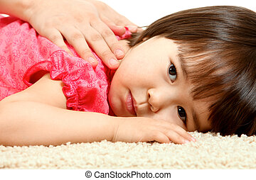 Restful child - Portrait of small girl relaxing with serene...