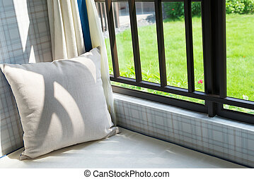 resting area of a cozy window seat with cushion in the ...
