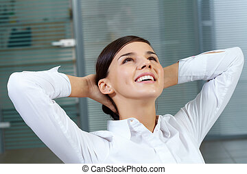Resting at workplace - Image of young secretary resting at...